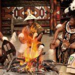 Men around a fire at Lesedi cultural village
